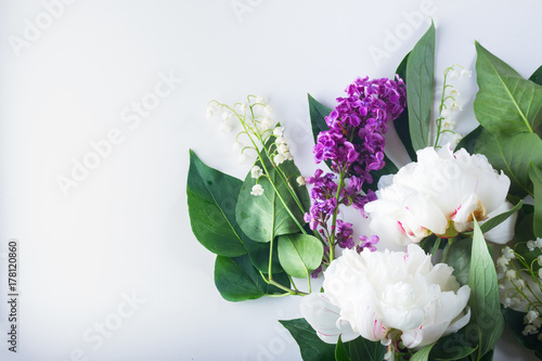 Floral flat lay scene of fresh flowers - lilac, peonies and lilly of the walley Poster