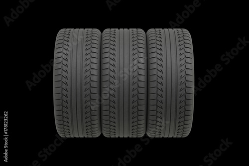 © PixlMakr - Fotolia.com Three tyres on black background