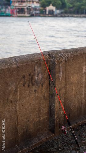 Fotobehang Guilin Fishing pole resting on a wall