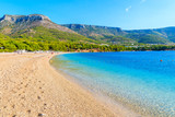 View of empty Zlatni Rat beach with beautiful sea water and mountains in background, Brac island, Croatia - 178137854