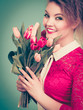 Woman holding bouquet of tulips flowers - 178164071
