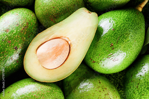 Closeup view of fresh ripe green avocados. Healthy eco food