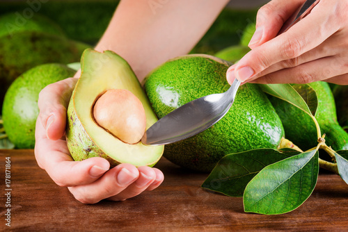 Woman peeling avocado. Healthy eco food