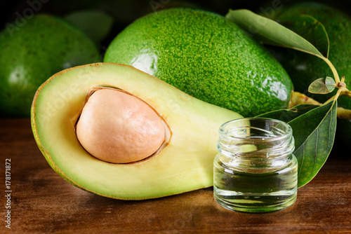 Closeup view of fresh avocado and natural avocado oil