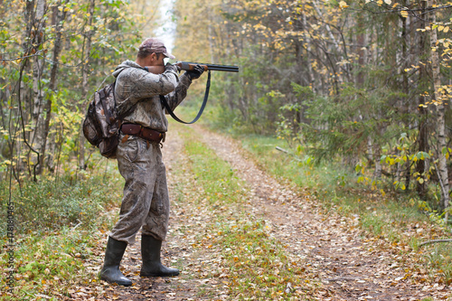 Fotobehang Jacht hunter taking aim from a shotgun