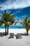 plank beds under palm trees, white sand - 178197812