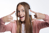 Close up of teenage girl showing sign of horns - 178206277