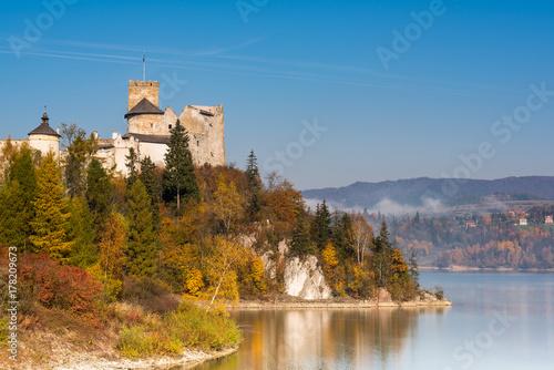 Nidzica Castle over lake in Poland Poster