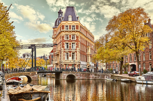 Foto op Plexiglas Amsterdam Channel in Amsterdam Netherlands Holland houses under river