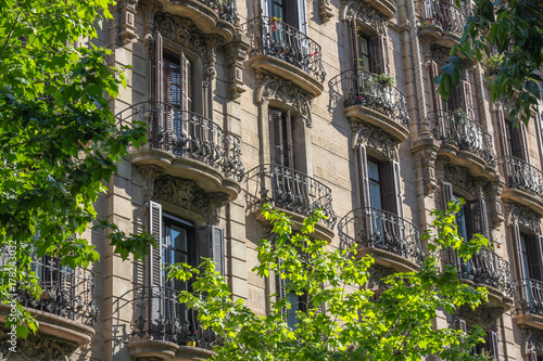 Fotobehang Barcelona Apartments with wrought iron balconies in Eixample, Barcelona, Spain.