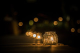 candle light in glass small jar - 178246027