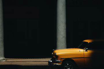Shadow hides yellow retro car