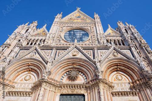 Deurstickers Toscane The view of upper facade detail of Duomo di Siena or Metropolitan Cathedral of Santa Maria Assunta.