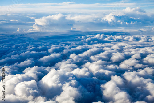 Fototapeta Beautiful, dramatic clouds and sky viewed from the plane