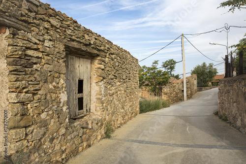 Foto op Canvas Baksteen muur a street in Muro de Agreda village, province of Soria, Spain