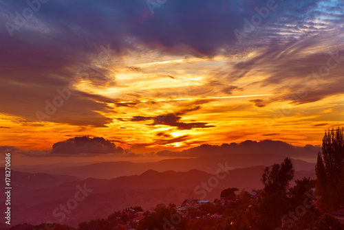 Foto op Plexiglas Bordeaux Amazing mountain landscape with colorful vivid sunset on the bright sky, natural outdoor travel background