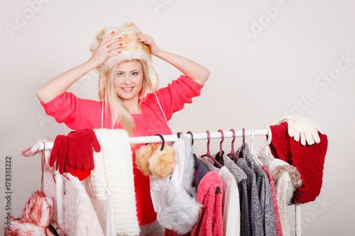 Attractive woman wearing furry winter hat Poster
