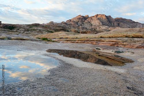 Papiers peints Cappuccino Views of Mount Bektau Ata. Bektau Ata - a mountainous area in the middle of the Kazakhstan steppe, within a radius of about 5-7 km.