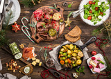 Flat lay of Delicious Christmas themed dinner table with roasted meat steak, appetizers and desserts. Top view. Holiday concept. - 178317259