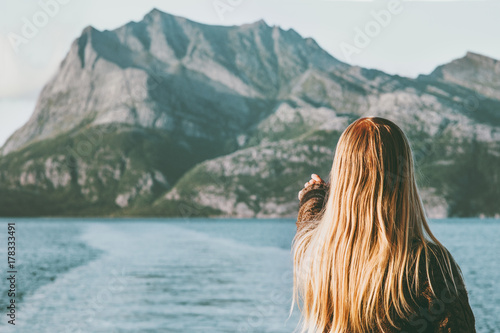 Blonde Woman traveling by ferry enjoying Norway mountains and sea landscape Travel Lifestyle concept adventure vacations outdoor