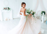 beautiful bride in a luxurious dress in eco-style