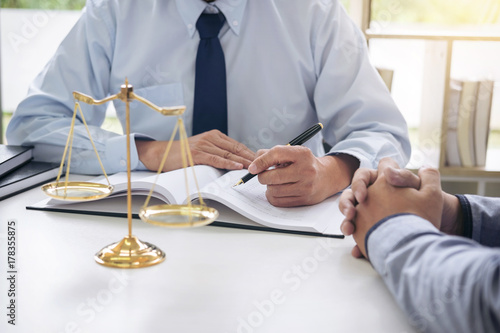 Judge gavel with scales of justice, Business people and male lawyers discussing contract papers at law firm in office. Concepts of law