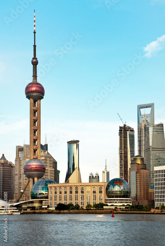 Fotobehang Shanghai China. City of Shanghai. View of skyscrapers in Pudong and Oriental Pearl Tower from the Huangpu River at the summer afternoon