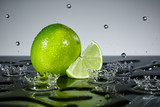 Lime with raindrops on grey background