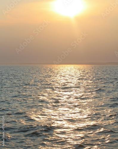 Papiers peints Beige Sunset Over Open Water