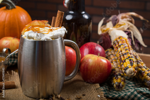 Foto op Canvas Chocolade Cider in a silver stainless mug with fall decorations