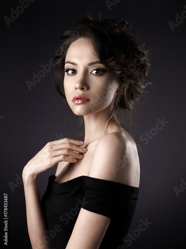 Fotobehang Women Art Beautiful woman with elegant hairstyle on black background