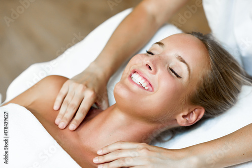 Fotobehang Spa Young woman receiving a head massage in a spa center.
