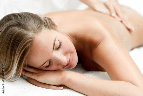 Leinwanddruck Bild Young blonde woman having massage in the spa salon