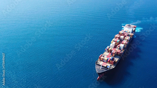 Leinwanddruck Bild Ultra large container vessel (ULCV) at sea - Aerial image