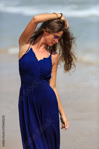 Sexy fashion model posing on the beach Poster
