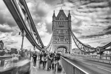 LONDON - SEPTEMBER 25, 2016: Beautiful view of Tower Bridge along Thames river. London attracts 30 million tourists annually