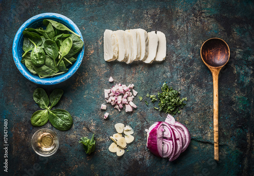 Vegetarian flavor ingredients for tasty dishes on rustic kitchen table background with cooking spoon , top view, flat lay. Healthy eating and cooking, clean or diet food concept