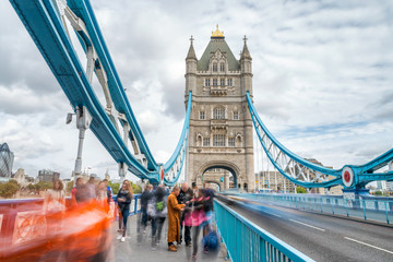 Tourists along Tower Bridge in London, blurred view with long exposure