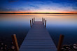 Relaxing view of dock going out onto Torch lake in northern Michigan
