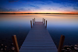 Fototapety Relaxing view of dock going out onto Torch lake in northern Michigan