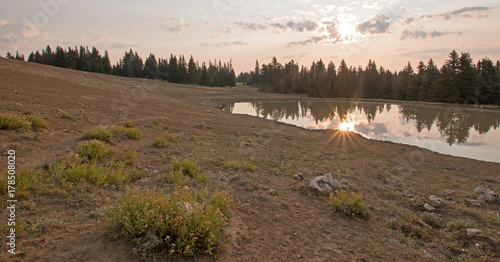 Fotobehang Diepbruine Sunrise over wild horse water hole at dawn in the Pryor Mountains Wild Horse Range in Montana United States