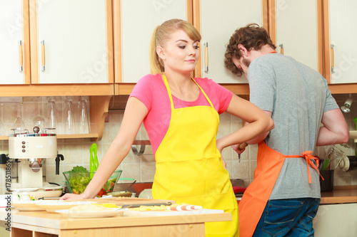 Couple woman and man cooking in kitchen.