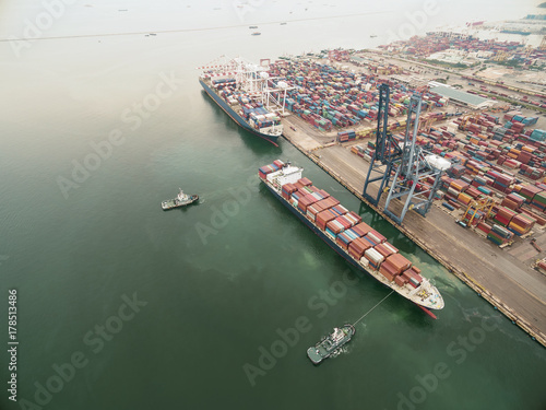 two tug boat towing cargo container in warehouse harbor at thailand Poster