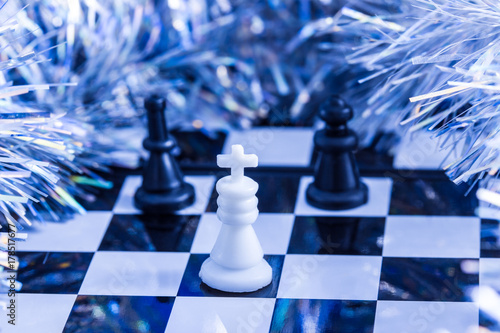 Poster chess and christmas fluffy decoration around the game board