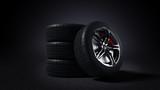 3D illustration of car rim and tyre standing on asphalt