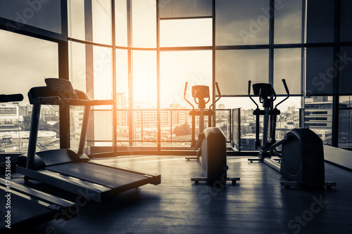 Treadmill in fitness room background with color tone and light