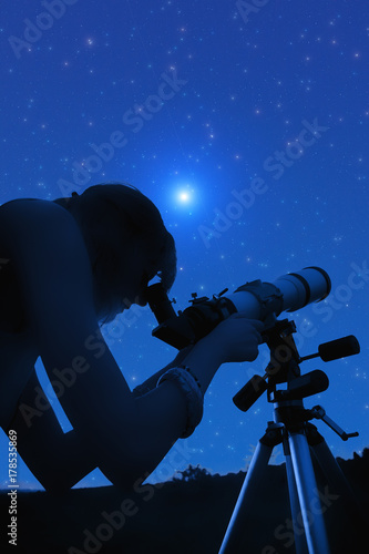 Fototapeta Silhouette of a girl while watching stars through the telescope.