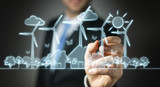 Businessman drawing renewable energy sketch
