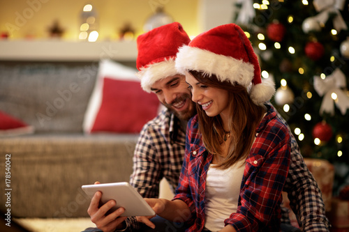 Christmas couple celebrating holiday