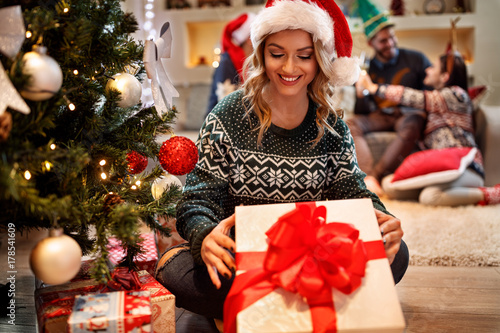 Smiling woman with Christmas gift
